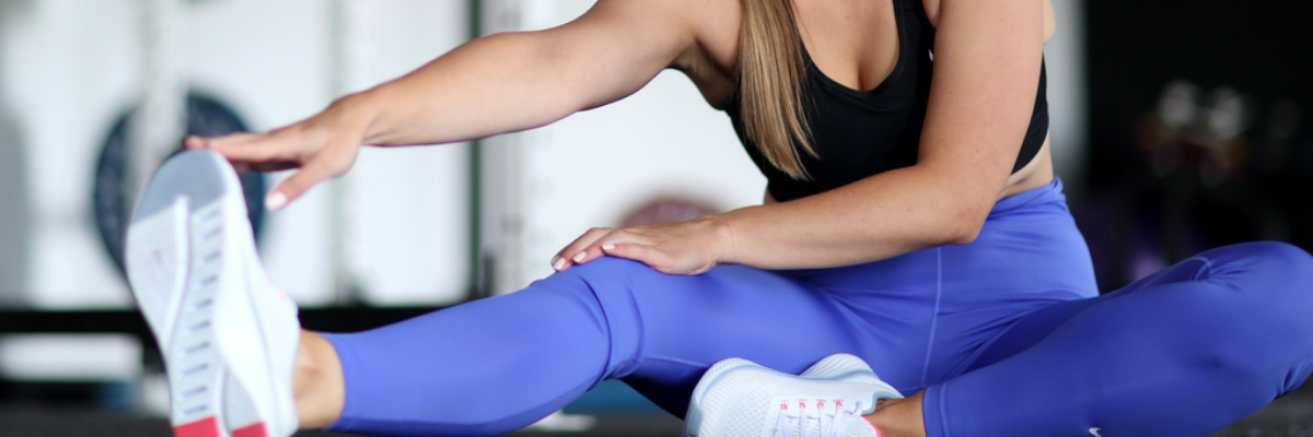 Woman stretching after workout