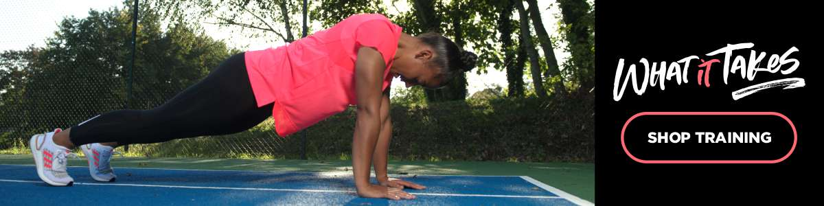 Rianna Jarret doing push ups outside on a court wearing adidas