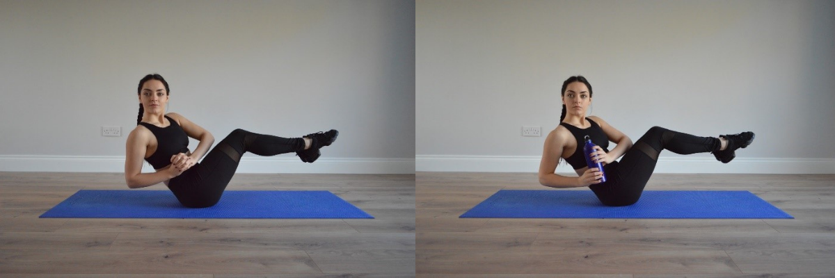 Fitness model in v-sit position at home, holding water bottle>